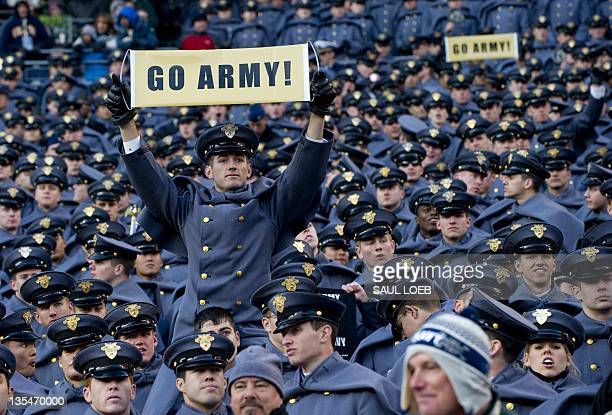 Army cadets attend the Army vs Navy football game at Fedex Field in Landover Maryland December 10 2011 AFP PHOTO / Saul LOEB