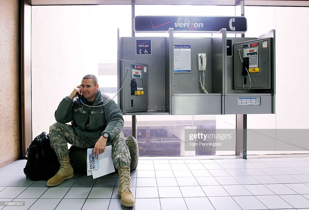 U.S. Army Capt. Fred Hale with the Idaho National Guard 116th Brigade Special Troops Battalion waits on hold while trying to rebook a flight home to Idaho after an overnight ice storm forced the closure of DFW International Airport on February 1, 2011 in Dallas, Texas. A major ice storm hit the Dallas/Fort Worth area overnight days before Super Bowl XLV is to be be held in Arlington, Texas.