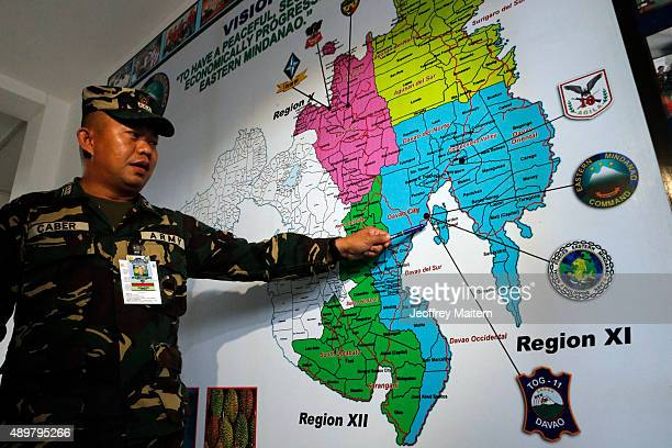 Army Captain Alberto Caber regional military spokesman uses a map to show the coverage of their pursuit operation on September 24 2015 to recover two...