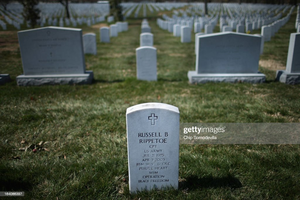 U.S. Army Captain Russell B. Rippetoe's headstone stands in Arlington Cemetery's Section 60 on the 10th anniversary of the beginning of the war in Iraq March 19, 2013 in Arlington, Virginia. Rippetoe was killed in a suicide bombing at a checkpoint near the Hadithah Dam northwest of Baghdad, Iraq. He was the first soldier killed in Operation Iraqi Freedom to be buried at Arlington National Cemetery.