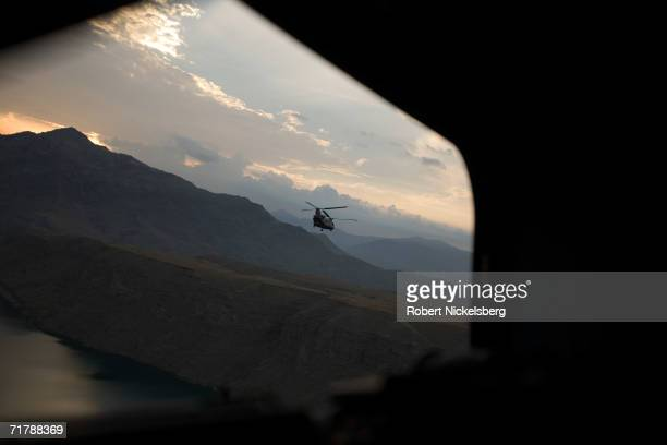 A US Army CH47 helicopter flies over a reservoir in Nangahar Province on a resupply flight from Bagram Air Base to a final destination in Kunar...