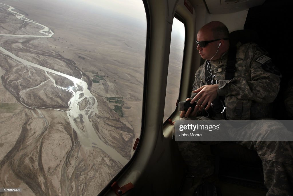 U.S. Army chaplain Carl Subler flies over the Argandab River while moving between bases to celebrate Catholic Mass for soldiers on March 9, 2010 in Kandahar province, Afghanistan. Military chaplains travel the battlefield throughout Afghanistan, providing a backbone of support for thousands of soldiers struggling with the difficulties of war and year-long deployments away from home.