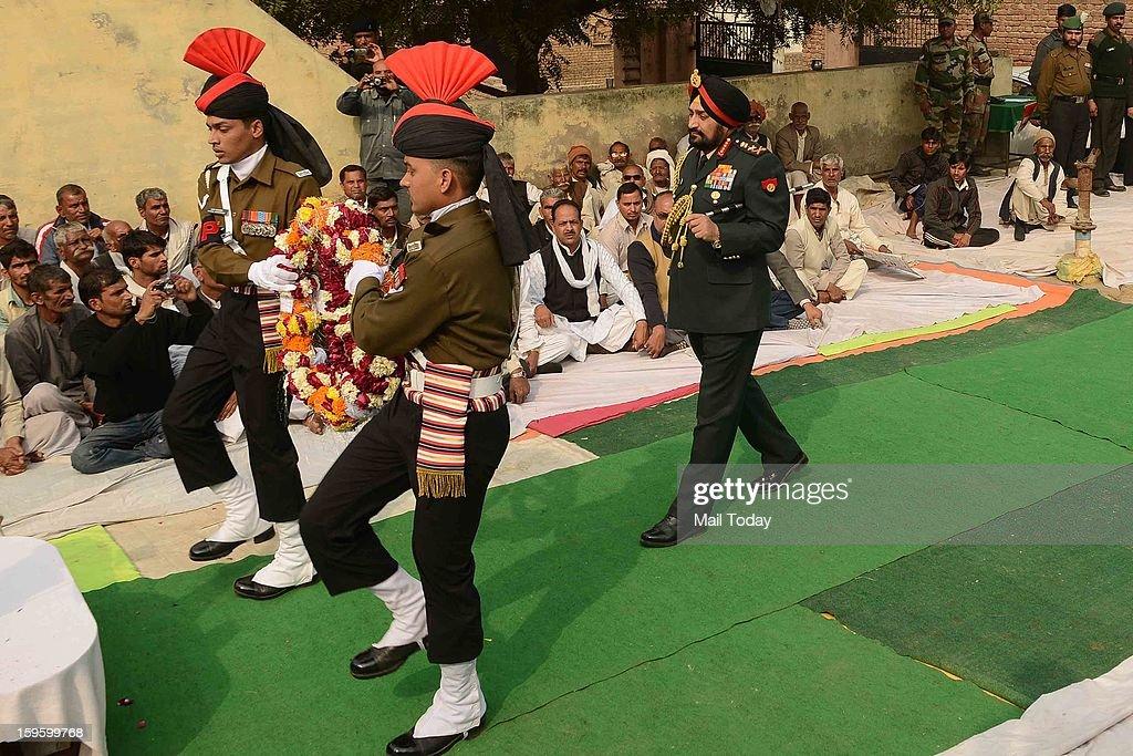 Army Chief Gen Bikram Singh pays tribute to lance Naik Hemraj at village Shernagar near Mathura on Wednesday.