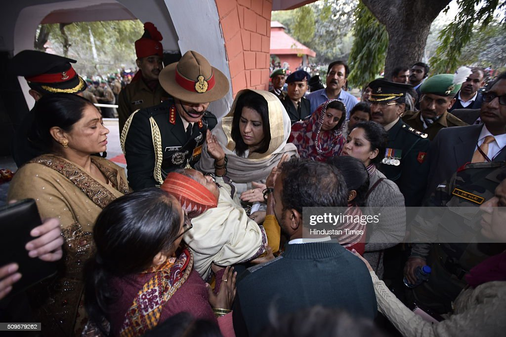 Army Chief General Dalbir Singh and his wife Namita Suhag console the family members of the rescued soldier Lance Naik Hanumanthappa during his funeral ceremony at Brar square crematorium on February 11, 2016 in New Delhi, India. Lance Naik Hanamanthappa Koppad of 19 Madras Regiment was rescued alive on night after being buried under 35 feet of snow for six days. The lone survivor of the February 3 Siachen avalanche that claimed the lives of nine soldiers, breathed his last at the Army RR Hospital in Delhi.