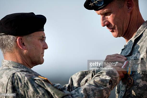 Army Chief of Staff Gen George W Casey Jr awards Gen Stanley McChrystal the Army Distinguished Service Medal during a retirement ceremony at Fort...