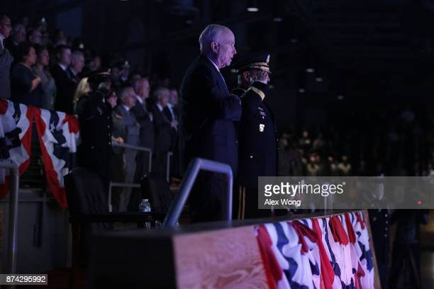 S Army Chief of Staff Gen Mark A Milley and Sen John McCain listen to the national anthem during a special Twilight Tattoo performance November 14...