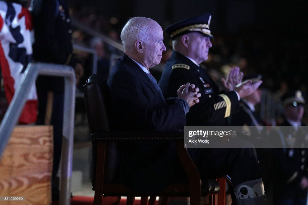 U.S. Army Chief of Staff Gen. Mark A. Milley (R) and Sen. John McCain (R-AZ) (L) watch a special Twilight Tattoo performance November 14, 2017 at Fort Myer in Arlington, Virginia. Sen. McCain was honored with the Outstanding Civilian Service Medal for over 63 years of dedicated service to the nation and the U.S. Navy.