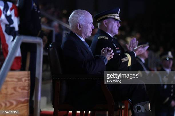 S Army Chief of Staff Gen Mark A Milley and Sen John McCain watch a special Twilight Tattoo performance November 14 2017 at Fort Myer in Arlington...