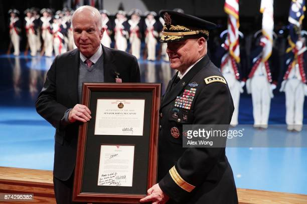S Army Chief of Staff Gen Mark A Milley presents Sen John McCain with the Outstanding Civilian Service Medal during a special Twilight Tattoo...