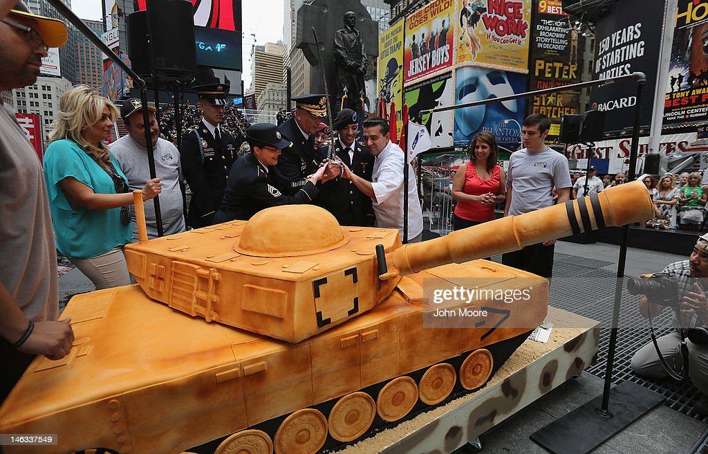U.S. Army Chief of Staff Gen. Raymond Odierno cuts a cake marking the Army's 237th anniversary on June 14, 2012 in Times Square in New York City. Odierno was joined by fellow Army troops as he swore in 16 new recruits in a ceremony celebrating the Army's birthday. ''Cake Boss'' reality show Buddy Valastro (R), helped Odierno cut the 500 pound cake in the shape of a tank, which Valastro said took 8 of his staff three days to prepare for the event.