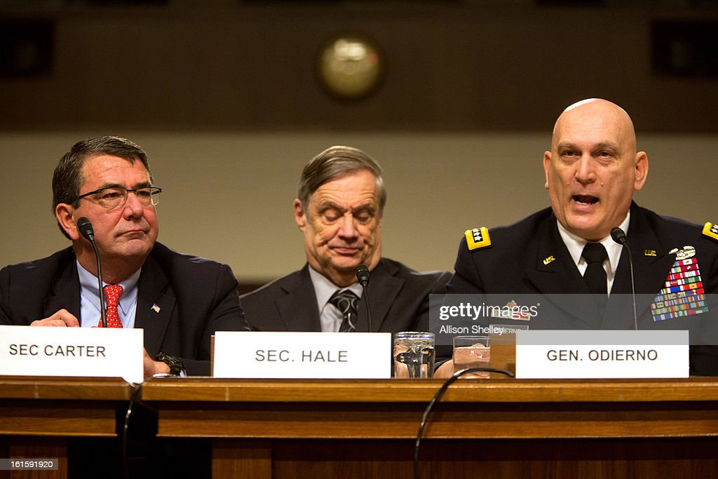 Army Chief of Staff Gen. Raymond Odierno (R) speaks as Deputy Defense Secretary <a gi-track='captionPersonalityLinkClicked' href=/galleries/search?phrase=Ashton+Carter&family=editorial&specificpeople=956792 ng-click='$event.stopPropagation()'>Ashton Carter</a> (L) and Defense Undersecretary Robert Hale listen during a hearing before the Senate Armed Services Committee on the impacts of sequestration and/or a full-year continuing resolution on the Defense Department, n Capitol Hill February 12, 2013 in Washington, DC. In order to pay down the deficit the cuts are designed to force savings of $1.2 trillion through 2021.