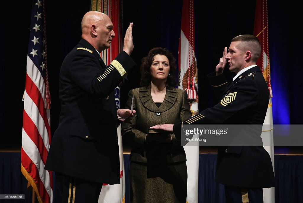 U.S. Army Chief of Staff Gen. Raymond Odierno (L) swears in Command Sgt. Maj. Daniel Dailey (R) as the 15th sergeant major of the Army as Dailey's wife Holly (C) looks on January 30, 2015 at the Pentagon in Arlington, Virginia. Dailey succeed Raymond Chandler to the position.