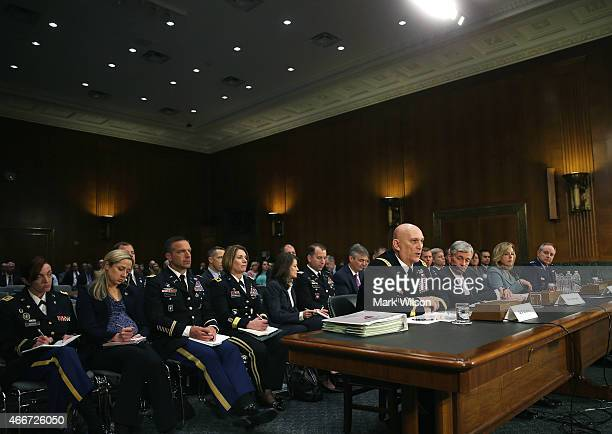 Army Chief of Staff Gen Raymond Odierno testifies while flanked by Secretary of the Army John McHugh Secretary of the Air Force Deborah Lee James and...