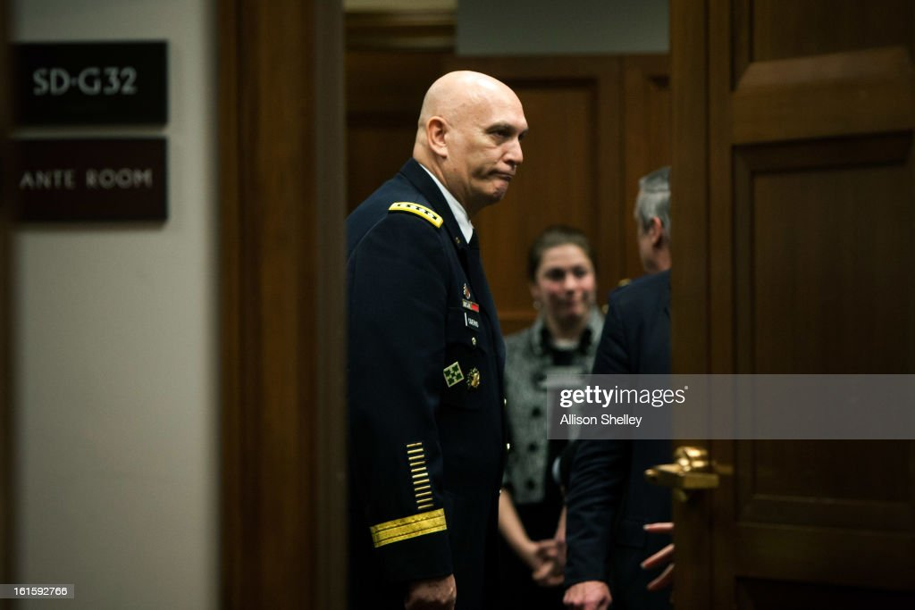 Army Chief of Staff Gen. Raymond Odierno waits in an anteroom for testimony to resume during a hearing in which defense department officials are testifying before the Senate Armed Services Committee on the impacts of sequestration and/or a full-year continuing resolution on the Defense Department, on Capitol Hill February 12, 2013 in Washington, DC. In order to pay down the deficit the cuts are designed to force savings of $1.2 trillion through 2021.