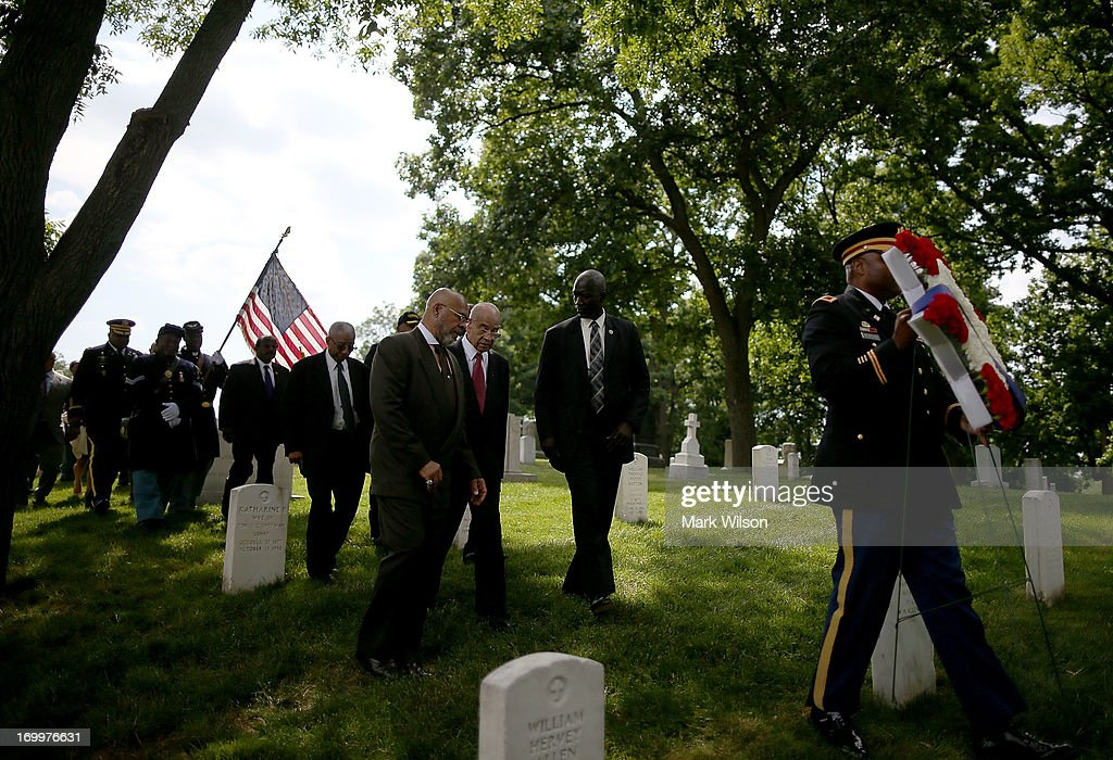 U.S. Army Col. Cornado Morgan carries a wreath to be laid at the gravesite of Buffalo Soldier Col. Charles Young, at Arlington Cemetery, June 5, 2013 in Arlington, Virginia. The event was hosted by the National Coalition of Black Veterans and the Omega Psi Phi Fraternity to celebrate the 90th anniversary of 'Buffalo Soldier' and military leader Col. Charles Young's internment in Arlington Cemetery.