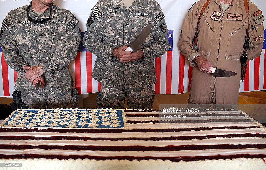U.S. Army Colonel <a gi-track='captionPersonalityLinkClicked' href=/galleries/search?phrase=Thomas+Jones&family=editorial&specificpeople=203187 ng-click='$event.stopPropagation()'>Thomas Jones</a>, U.S. Army Brigadier General Reynold Hoover and Brigadier General Guy Walsh prepare to cut a big American flag cake during an Independence Day BBQ for troops at Kandahar Airfield July 4, 2010 in Kandahar, Afghanistan. Troops stationed at Kandahar Airfield were treated to a BBQ dinner and entertainment to celebrate Independence Day. Gen. David Petraeus formally assumed command of the 130,000-strong international force in Afghanistan today replacing Gen. Stanley McChrystal.