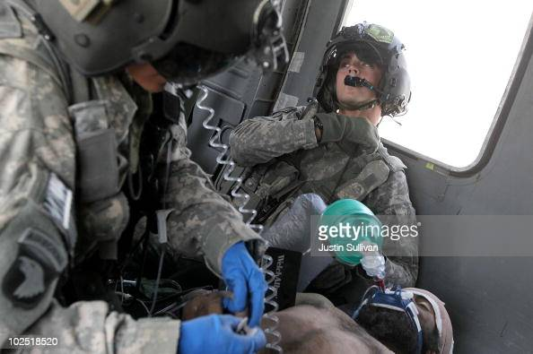 S Army Corporal Samuel Bard from Charlie Co Sixth Battalion 101st Airborne Combat Aviation Brigade Task Force Shadow uses a bag valve mask to...