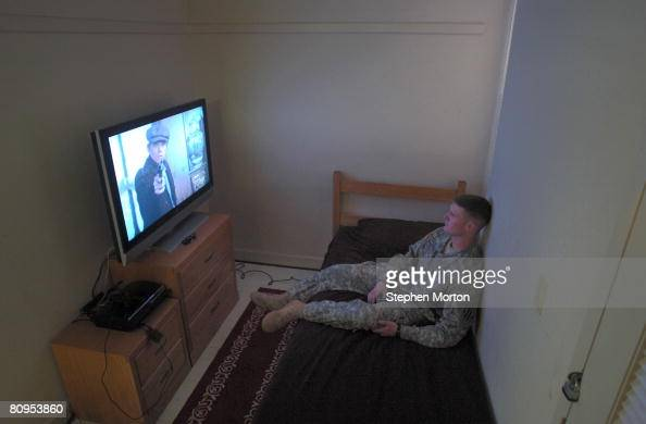 S Army Cpl Aaron Washburn watches a DVD May 1 2008 in Fort Stewart Georgia The 3rd Infantry Division houses some soldiers in VOLAR or Voluntary Army...