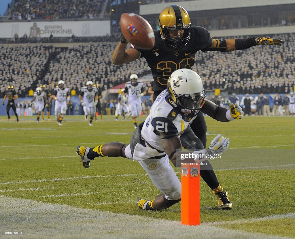 Army defensive back Brandon Fusilier-Jeffires covers Navy's Gee Gee Greene (21), who fails to catch a deep pass in the second quarter on Saturday, December 8, 2012, in Philadelphia, Pennsylvania. The Navy Midshipmen defeated the Army Black Knights, 17-13.