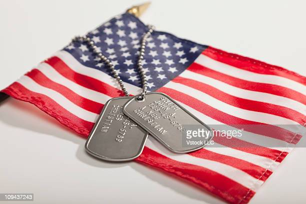 Army dog tags on Stars and Stripes flag