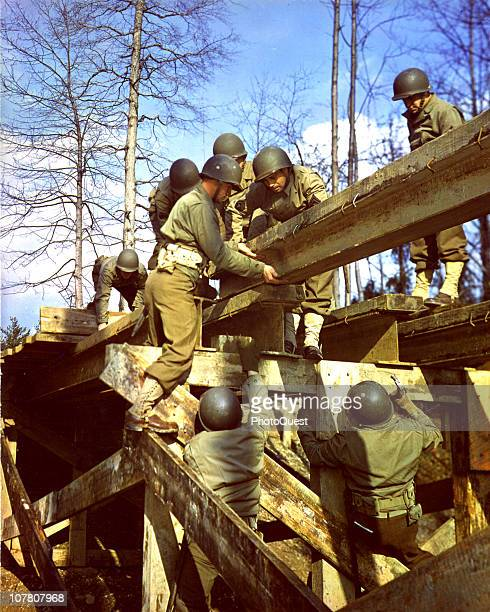 US Army engineers construct a bridge during stateside training maneuvers 1944