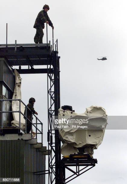 Army Engineers remove powerfull surveilance cameras from the top of the Romeo101 Observation post near Camlough in South Armagh as the British...