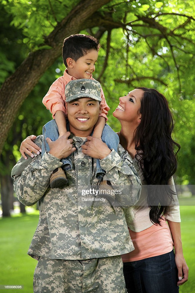 Army Family Series: Young US Soldier with Wife & Son : Stock Photo