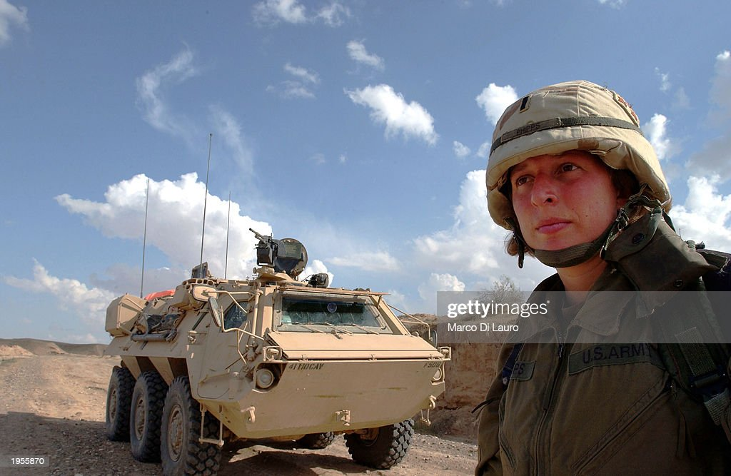 S Army First Lt Valerie Phipps of Sherwood Arkansas stands near a FOX NBC Reconaissance Unit from the 1st Squadron of the 4th Infantry Division used...