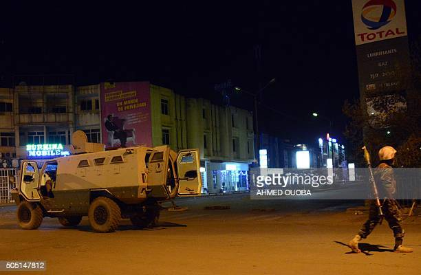 Army forces drive near Hotel Splendid where the attackers remain with sporadic gunfire continuing in Burkina Faso's capital Ouagadougou on January 15...