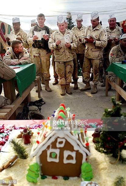Army Fourth Infantry Division soldiers sing carols during Christmas dinner December 25 2003 in Samarra Iraq Three US soldiers were killed when an...
