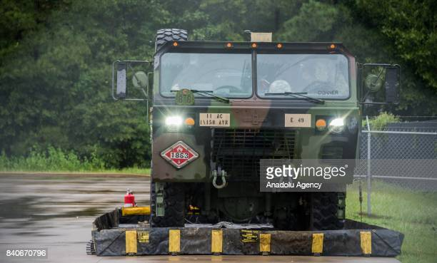 Army fuel truck awaiting their helicopter at the MCHD EMS Station 30 heliport during hurricane Harvey in Humble TX United States on August 29 2017