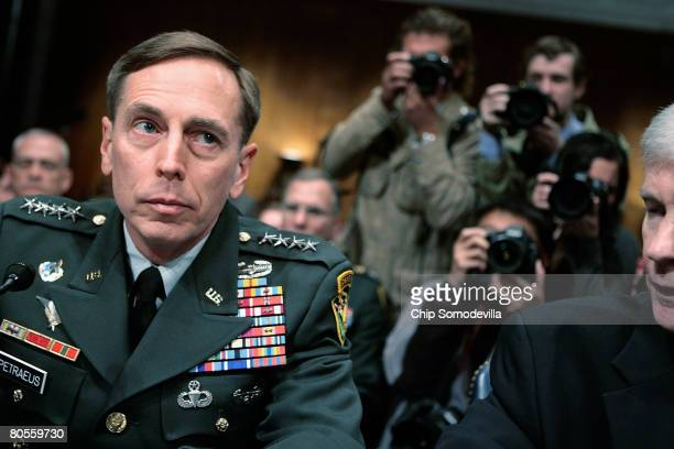 S Army Gen David Petraeus Commander of American forces in Iraq and US Ambassador to Iraq Ryan Crocker prepare to testify before the Senate Armed...