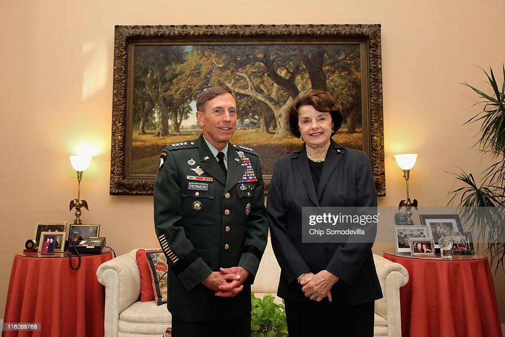U.S. Army Gen. <a gi-track='captionPersonalityLinkClicked' href=/galleries/search?phrase=David+Petraeus&family=editorial&specificpeople=175826 ng-click='$event.stopPropagation()'>David Petraeus</a> (L), commander of U.S. and ISAF forces in Afghanistan, poses for photographs with Senate Select Committee on Intelligence Chairman Sen. <a gi-track='captionPersonalityLinkClicked' href=/galleries/search?phrase=Dianne+Feinstein&family=editorial&specificpeople=214078 ng-click='$event.stopPropagation()'>Dianne Feinstein</a> (D-CA) in her office on Capitol Hill June 15, 2011 in Washington, DC. President Barack Obama has nominated Petraeus to be the next director of the Central Intelligence Agency.