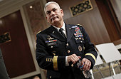 Army Gen John Campbell commander of the International Security Assistance Force US ForcesAfghanistan waits to testify before the Senate Armed...