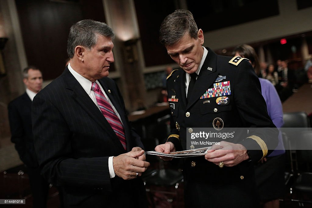 U.S. Army Gen. Joseph Votel (R), nominee to be the next commander of the U.S. Central Command, confers with Sen. <a gi-track='captionPersonalityLinkClicked' href=/galleries/search?phrase=Joe+Donnelly&family=editorial&specificpeople=3269744 ng-click='$event.stopPropagation()'>Joe Donnelly</a> (L) (D-IN) before the start of hearing held by the Senate Armed Services Committee March 9, 2016 in Washington, DC. The committee heard testimony from the two military leaders on their nominations.