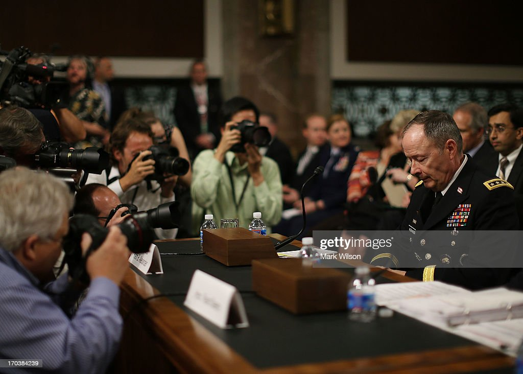U.S. Army Gen. Keith Alexander, commander of the U.S. Cyber Command, director of the National Security Agency (NSA) is surrounded by photographers after arriving at a Senate Appropriations Committee hearing on Capitol Hill, June 12, 2013 in Washington, DC. The committee is hearing testimony on Cybersecurity from Gen. Keith Alexander and other goverment officials.