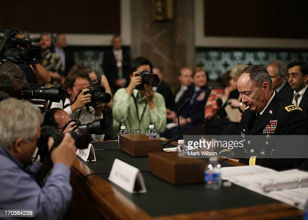 S Army Gen Keith Alexander commander of the US Cyber Command director of the National Security Agency is surrounded by photographers after arriving...