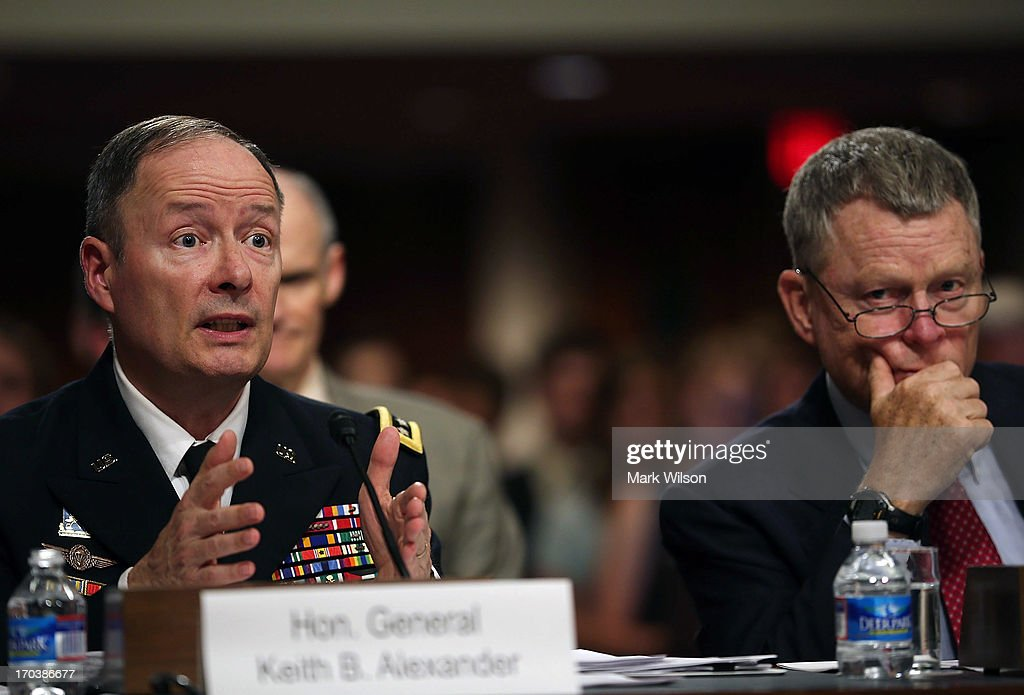 U.S. Army Gen. Keith Alexander (L), commander of the U.S. Cyber Command, director of the National Security Agency (NSA), and Rand Beers (R), Acting Deputy Homeland Security Secretary, answer questions during a Senate Appropriations Committee hearing on Capitol Hill, June 12, 2013 in Washington, DC. The committee is hearing testimony on President Obama's FY 2014 budget and also Cybersecurity from Gen. Keith Alexander and other goverment officials.