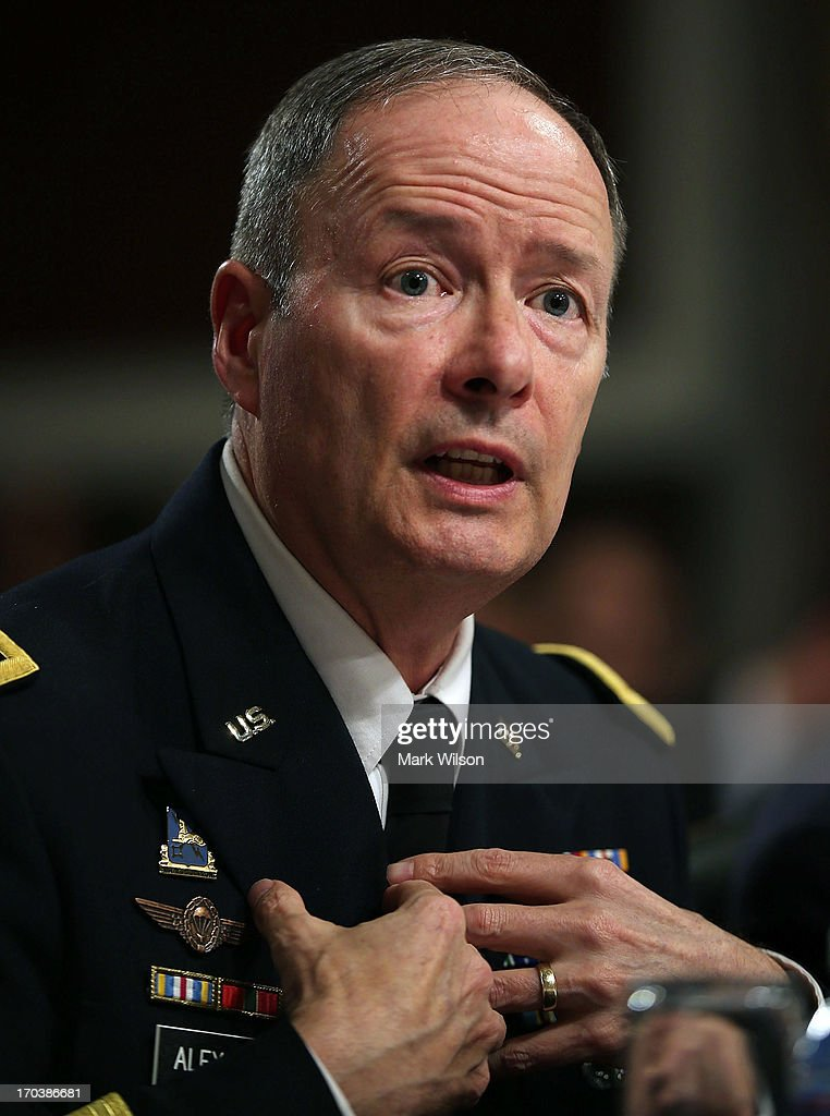 U.S. Army Gen. Keith Alexander, commander of the U.S. Cyber Command, director of the National Security Agency (NSA), testifies during a Senate Appropriations Committee hearing on Capitol Hill, June 12, 2013 in Washington, DC. The committee is hearing testimony on President Obama's FY 2014 budget and also Cybersecurity from Gen. Keith Alexander and other goverment officials.
