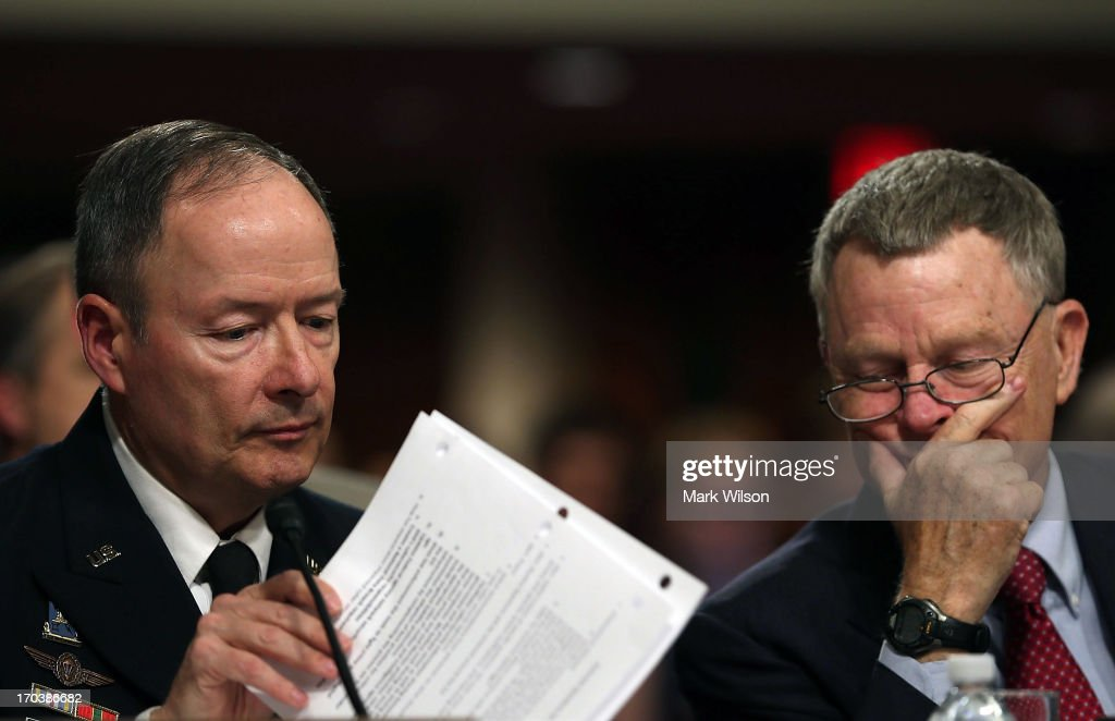 U.S. Army Gen. Keith Alexander (L), commander of the U.S. Cyber Command, director of the National Security Agency (NSA), and Rand Beers (R), Acting Deputy Homeland Security Secretary, look over papers during a Senate Appropriations Committee hearing on Capitol Hill, June 12, 2013 in Washington, DC. The committee is hearing testimony on President Obama's FY 2014 budget and also Cybersecurity from Gen. Keith Alexander and other goverment officials.