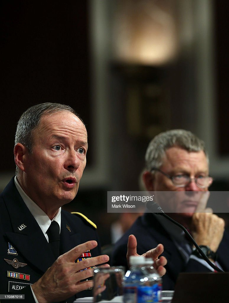 U.S. Army Gen. Keith Alexander (L), commander of the U.S. Cyber Command, director of the National Security Agency (NSA), and Rand Beers (R), Acting Deputy Homeland Security Secretary, participate in a Senate Appropriations Committee hearing on Capitol Hill, June 12, 2013 in Washington, DC. The committee is hearing testimony on President Obama's FY 2014 budget and also Cybersecurity from Gen. Keith Alexander and other goverment officials.