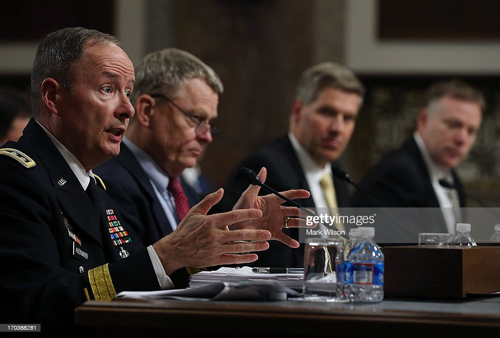 , U.S. Army Gen. Keith Alexander, commander of the U.S. Cyber Command, director of the National Security Agency (NSA), testifies while flanked by, Rand Beers, Acting Deputy Homeland Security Secretary, Patrick Gallagher Acting Deputy Commerce Secretary, director of the National Institute of Standards and Technology; and Richard McFeely, executive assistant director of the Federal Bureau of Investigation's Criminal, Cyber, Response, and Services Branch participate in a Senate Appropriations Committee hearing on Capitol Hill, June 12, 2013 in Washington, DC. The committee is hearing testimony on President Obama's FY 2014 budget and also Cybersecurity from Gen. Keith Alexander and other goverment officials.
