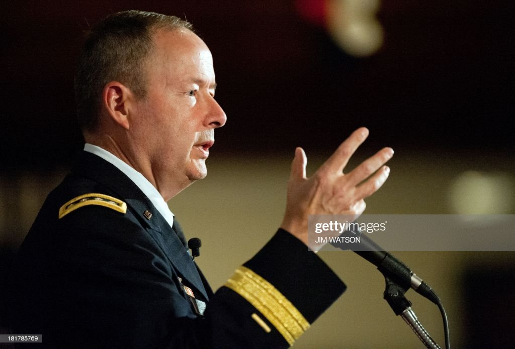 US Army Gen. Keith Alexander, commander of US Cyber Command and director of the National Security Agency (NSA), delivers opening keynote remarks September 25, 2013 during the fourth annual Cybersecurity Summit held in Washington, DC. The leader of the embattled National Security Agency doubled down Wednesday against calls from Capitol Hill to restrict US government surveillance programs a campaign he attributed to sensationalized reporting and media leaks. Alexander instead emphasized the NSA isnt listening to Americans phone calls and reading their emails, and he urged technology and government leaders at the conference to help get the facts out and get our nation to understand why we need these tools in the wake of Edward Snowdens disclosures. AFP PHOTO / Jim WATSON