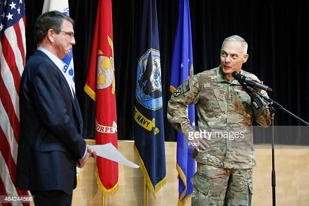 S Army General James Terry introduces Secretary of Defense Ash Carter to speak to troops at a questionandanswer session at Camp Arifjan on February...