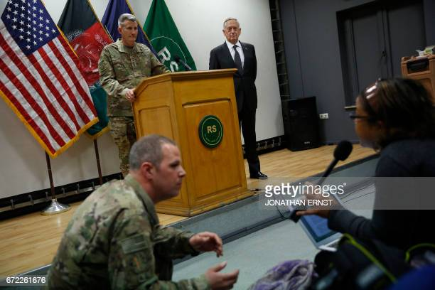 US Army General John Nicholson commander of US forces in Afghanistan and US Defense Secretary James Mattis hold a news conference at Resolute Support...