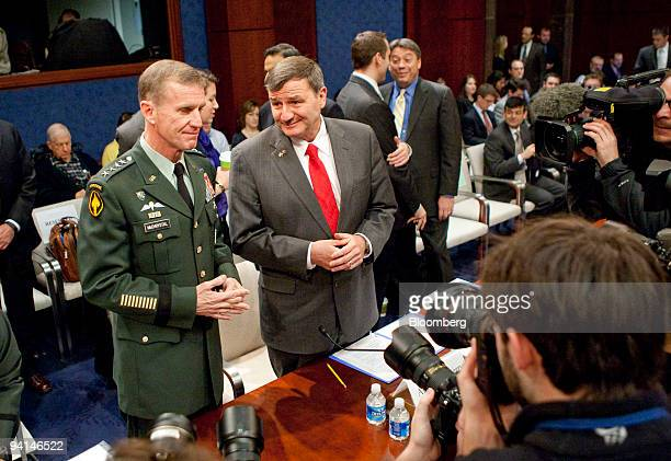 Army General Stanley McChrystal commander of US forces in Afghanistan left speaks to Karl Eikenberry US ambassador to Afghanistan during a House...