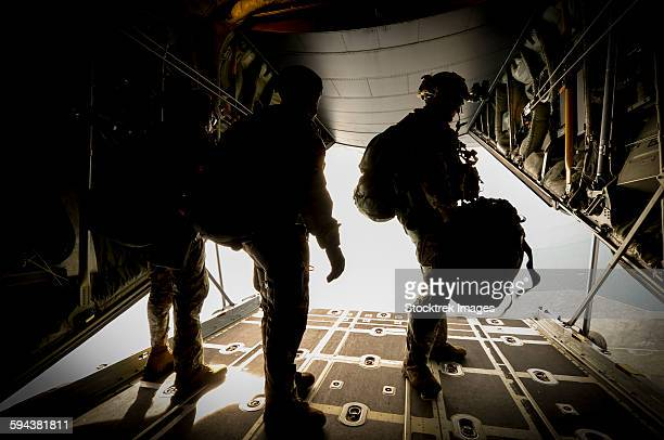 U.S. Army Green Berets wait to jump out of a C-130H3 Hercules.