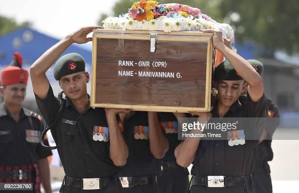 Army Guard of Honour carry the bodies of two soldiers after the Army Chief Bipin Rawat paid tribute to martyrs Naik Dipak Maity and Gnr/Opr...