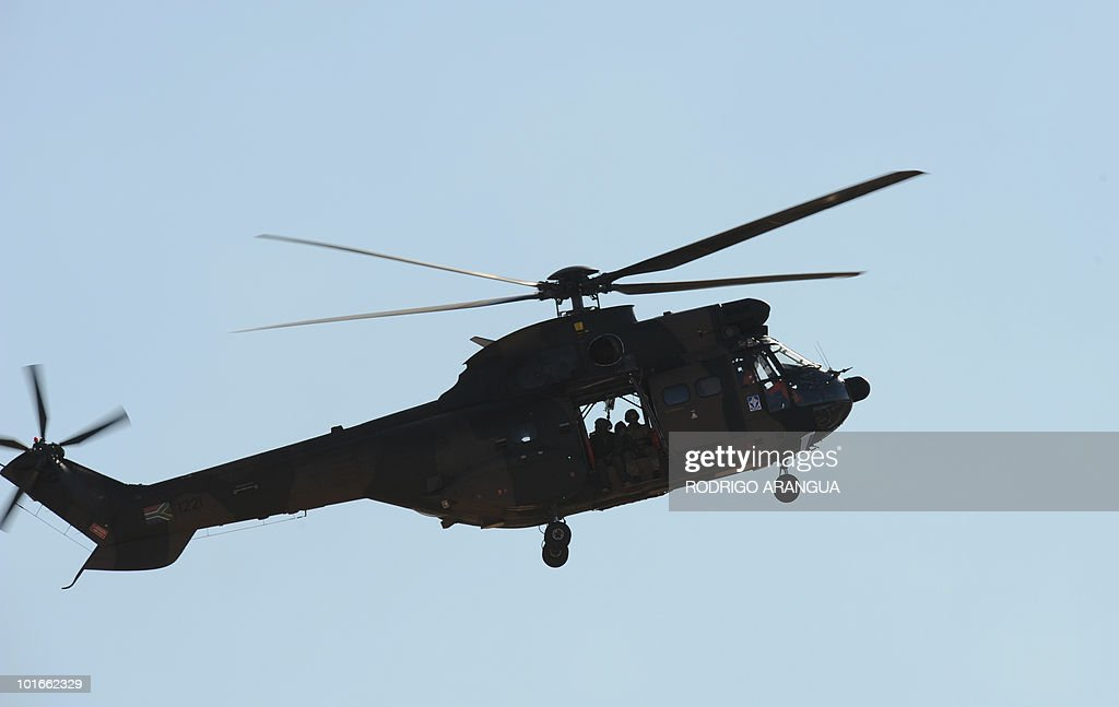 A Army helicopter flies over the GWK Park stadium in Kimberley before Uruguay's national football team's training sesion on June 6, 2010. Uruguay will play their first match of the 2010 World Cup on June 11 in Cape Town. AFP PHOTO / Rodrigo ARANGUA