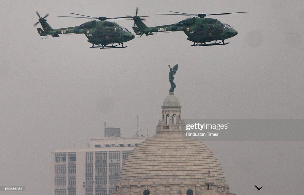 Army helicopters during 'Army Equipment Display and Military Tattoo' at Army Polo Ground, Race Course on February 2, 2013 in Kolkata, India.